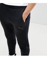 PUMA Evostripe Move - Pantalon de survêtement - Noir