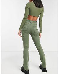 Collusion X008 - Jeans a zampa verde slavato