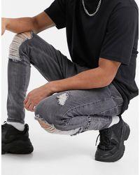 SIKSILK Vaqueros pitillo con roto en la rodilla grises