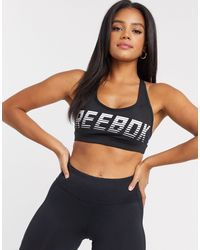 Reebok - Hero Racer Medium Impact Padded Sports Bra - Lyst