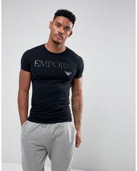 Emporio Armani Loungewear - T-shirt da casa nera con scritta del logo - Nero