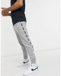 Nike Repeat Pack - Jogger resserré aux chevilles avec bandes - Gris