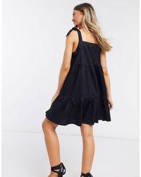 Monki - Черное Платье Мини Из Органического Хлопка С Присборенной Юбкой И Завязками На Плечах Thelma-черный Цвет - Lyst