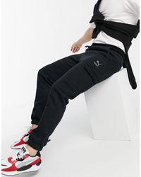 PUMA Pantaloni della tuta invernali neri - Nero