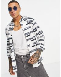 Armani Exchange Camisa blanca con estampado integral del logo - Blanco