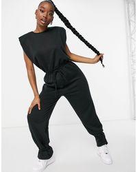 ASOS Combinaison jogger à épaulettes et chevilles nouées - Noir