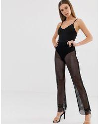 Lyst Asos Flare Trousers In Fishnet Mesh In Black