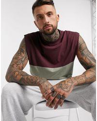 ASOS T-shirt oversize sans manches avec empiècement contrastant sur le haut - Kaki - Multicolore