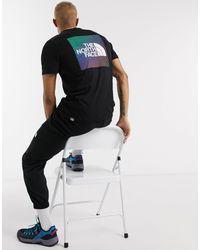 The North Face – es T-Shirt mit regenbogenfarbenem Box-Logo - Schwarz