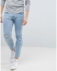 Mango - Man Skinny Jeans With Knee Rips In Mid Wash Blue - Lyst