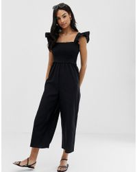 44db9567042 Lyst - ASOS Asos Bodyfit Jersey Jumpsuit With Wrap Bardot in Black