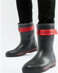 ASOS Wellies In Black With Red Tape Detail