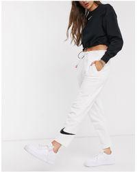Nike Slim Leg Swoosh White joggers