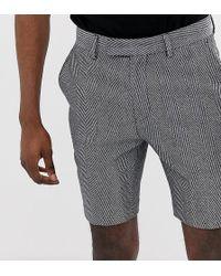 ASOS Pantalones cortos ajustados de vestir con diseño de espiga en azul