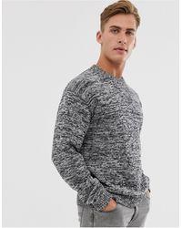 SELECTED – Pullover mit Rundhalsausschnitt aus schwarz meliertem Garn