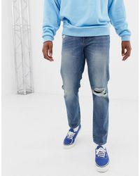 ASOS Jean slim 12.5oz avec genoux déchirés à délavage vintage moyen - Bleu
