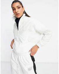 PUMA Tfs Track Jacket With White Leopard Print Colour Block