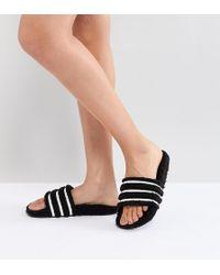 adidas Originals - Adilette Furry Slider Sandals In Black - Lyst
