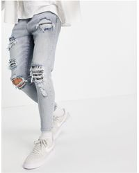 The Couture Club – jeans im used-look mit bandana-details - Blau
