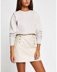River Island Minifalda beis acolchada con cinturón - Neutro