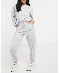 "ASOS – Trainingsanzug mit Oversized-Sweatshirt und Jogginghose mit dem Slogan ""Be Happy"" - Grau"