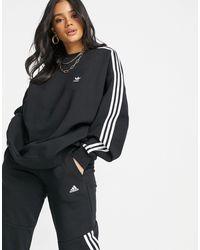 adidas Originals Adicolour - Felpa nera con tre strisce - Nero