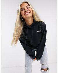 Nike Plus – Oversized-Kapuzenpullover mit kleinem Swoosh-Logo - Schwarz
