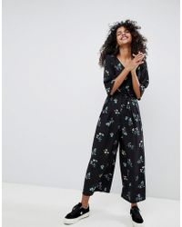 Monki - Dark Floral Printed Jumpsuit - Lyst