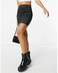 Naanaa Mini-jupe moulante d'ensemble en satin - Noir