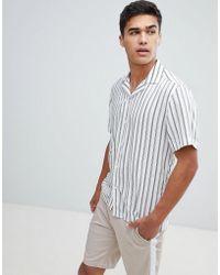 Reiss Camisa de corte slim y manga corta a rayas de - Blanco