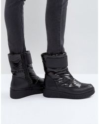 Calvin Klein | Jeans Leonie Black Quilted Boots | Lyst