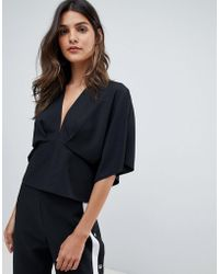 3ce8eb41c99 ASOS Top With Off Shoulder V Neck In Rib in Black - Lyst