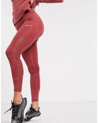 Nike - Leggings a vita alta rosa - Lyst