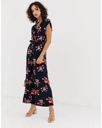 Vero Moda Jumpsuit Met Overslag En Bloemenprint - Blauw