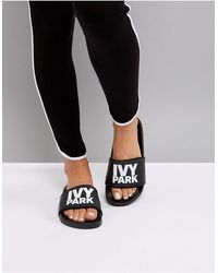 Ivy Park Sandales style mules avec logo - Noir
