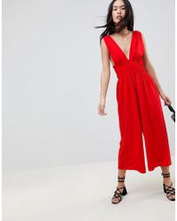 9d633ce86153 Lyst - ASOS Tall Wrap Front Wide Leg Jumpsuit in Pink