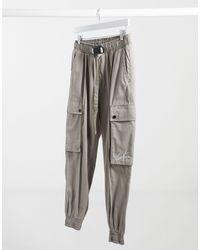 The Couture Club Pantalones cargo color piedra con diseño utilitario - Gris