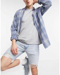 Levi's 412 - Pantaloncini di jeans slim invecchiati lavaggio chiaro wild west - Blu