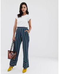 Esprit Pantaloni a righe con fondo ampio a righe blu navy e verdi