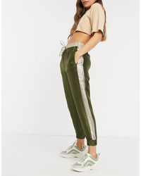 ONLY Tie Waist Satin joggers With Silver Side Stripe - Green