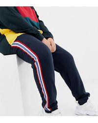 ASOS Plus - Joggers skinny blu navy con banda laterale