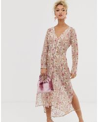 Never Fully Dressed Vestido camisero transparente con estampado floral multicolor - Rosa