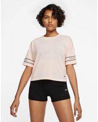 Nike Nike - Pro Training - T-shirt Met Logo - Roze