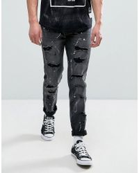 Reason - Distressed Jeans In Washed Black With Bleach Splat - Lyst