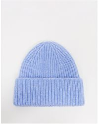 & Other Stories Gorro de canalé de lana en azul de