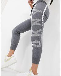 DKNY - Joggers con logo e fondo elasticizzato grigi - Lyst