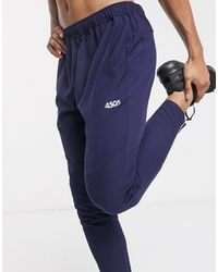 ASOS 4505 Woven Skinny Tapered Running joggers With Reflective Zip Detail - Blue