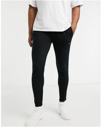 Good For Nothing Essentials joggers With Rubber Logo - Black