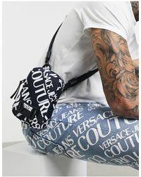 Versace Jeans Couture Versace Jeans – Couture – Beuteltasche mit All-over-Logo - Schwarz