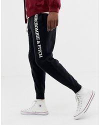 Abercrombie & Fitch Logo Cuffed Sweatpants In Black